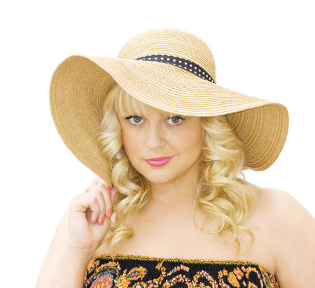 makeups: Summer fun - beautiful young woman wearing straw hat and strapless dress. Isolated over white background.