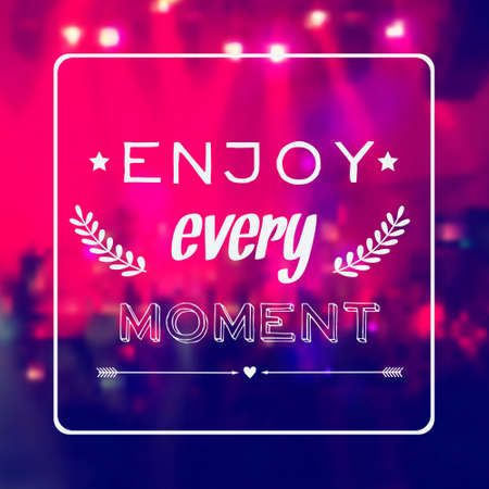 concert background: Vector motivational card  Enjoy every moment   Blurred background with rock stage and crowd