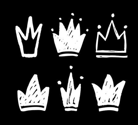 Vector set of abstract silhouettes of crowns. Hand drawn grunge icons isolated