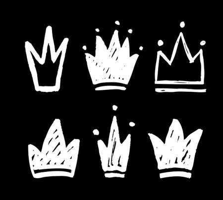 Vektorsatz der abstrakten Silhouetten der Kronen. Hand gezeichnete Schmutzflecken lokalisiert