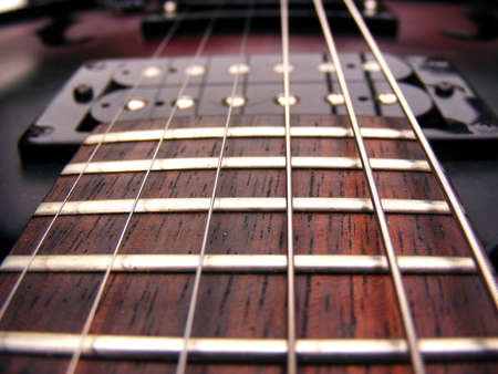 Guitar strings frets and pick ups electric guitar Stock Photo - 10854478