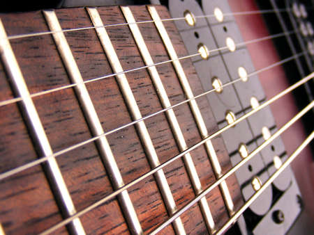 Electric Guitar strings frets and pick ups  photo