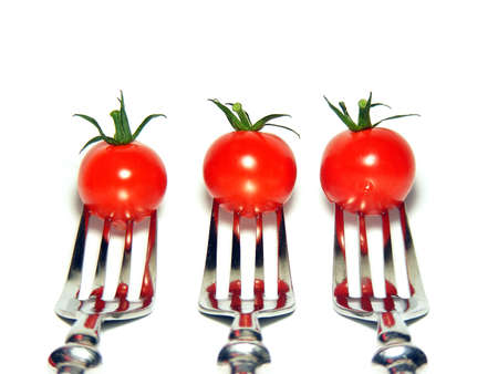 3 Cherry tomatoes on silver forks  Stock Photo - 11050772