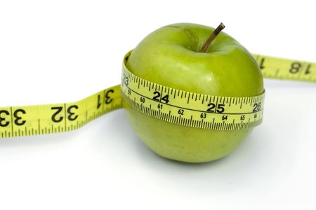 Green Apple with measuring tape photo