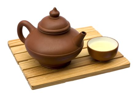 Teapot and teacup on a small wooden table photo
