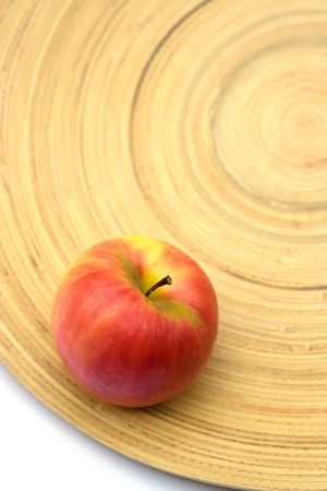 Red apple on a bamboo plate Stock Photo - 2014393