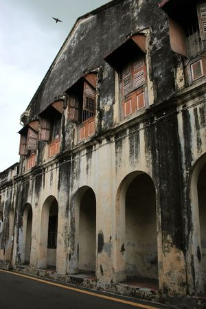 dilapidated wall: Dilapidated building in an old block of Georgetown, Malaysia Stock Photo