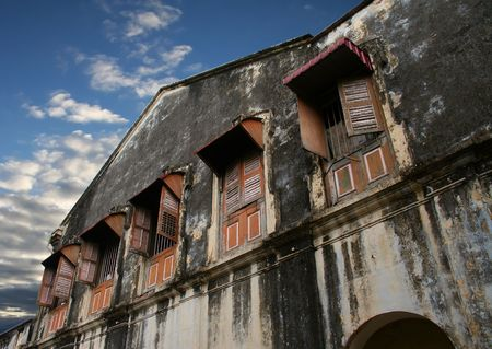 dilapidated: Dilapidated building in an old block of Georgetown, Malaysia Stock Photo