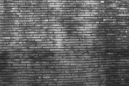 abandoned warehouse: dark brick wall texture in basement house interior with beam of light