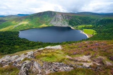 """Lough Tay aka """"Guinness lago"""" nella Contea di Wicklow Archivio Fotografico"""