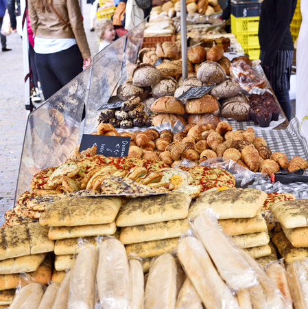 market stall: Baked goods at a bakery or market stall. Various pastries arrangement on a market stall. Stock Photo