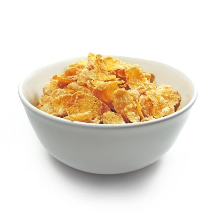 cornflakes: Cornflakes in a bowl, isolated on white