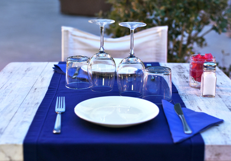 restaurant dining: Dinner table setting in the evening. Dinner for two at a restaurant.