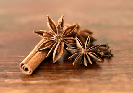 christmas spices: Close-up of christmas spices with copyspace. Cinnamon, star anise and clove on a wooden background.