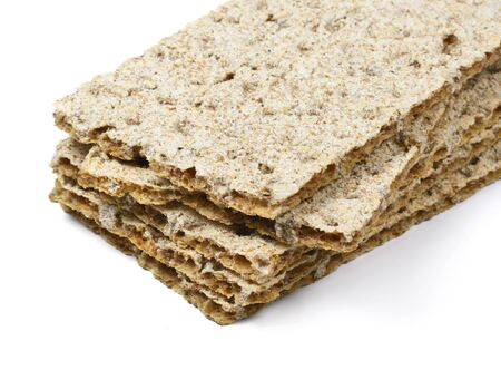 crispbread: stacked crispbread, isolated on white background. Stock Photo