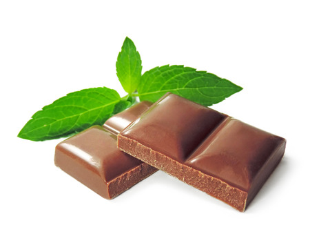 chocolate pieces: Chocolate pieces and mint leaves, isolated on white.