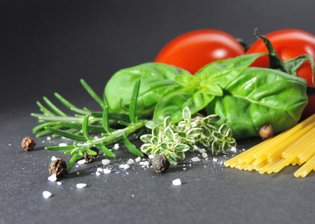 indigenous medicine: Ingredients for spaghetti with tomato sauce, isolated on black background Stock Photo