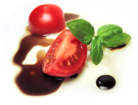 fresh tomato slice with oil and balsamic vinegar. Фото со стока