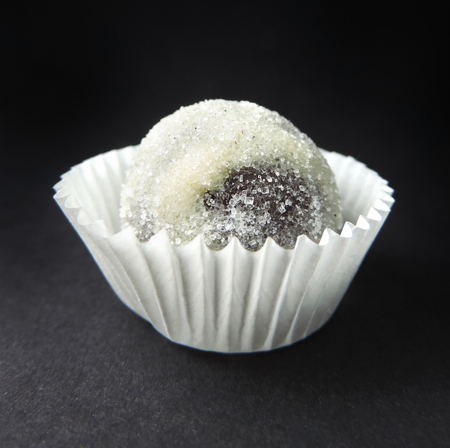 truffle: Chocolate truffle on black Stock Photo
