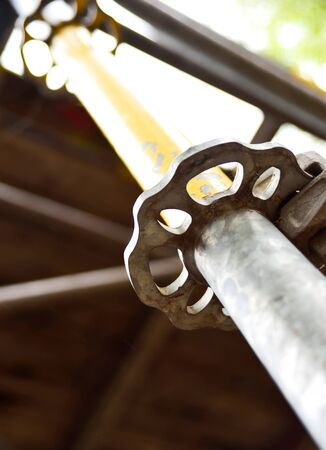 building sector: close-up of a scaffolding connection.