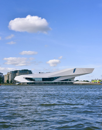 waterside: EYE Film institute of Amsterdam. Modern, futuristic building exterior of the EYE filmmuseum. Front view from the waterside.