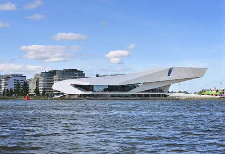 futuristic building: EYE Film institute of Amsterdam. Modern, futuristic building exterior of the EYE filmmuseum. Front view from the waterside.