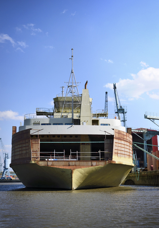 freight transportation: Freight shipping. Freight transportation. Hamburg harbor with on industrial ship anchored.