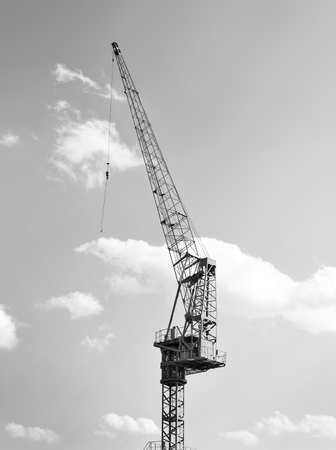 freight transportation: Harbor crane or freight crane at a commercial dock. Black and white image. Freight transportation.