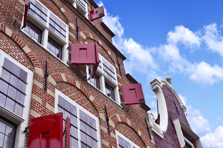 old town house: old town house of cobblestone with clear blue sky. Antique, traditional row house in the Netherlands.