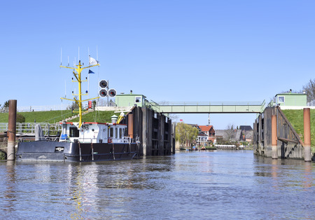 drawbridge: Steel drawbridge from water perspective. Shipping scene.