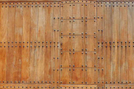 rivets: Wooden gate with rivets