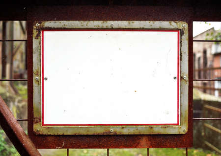 rotting: old, rotting signboard with copyspace Stock Photo