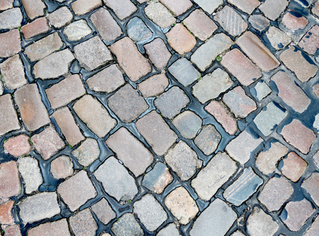 personal point of view: Cobblestone road, background Stock Photo