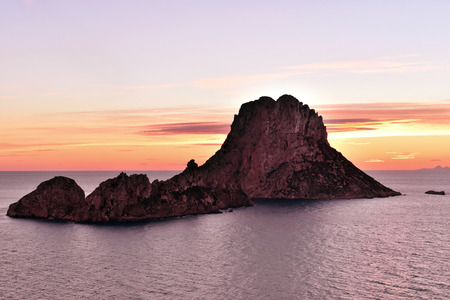 vedra: Es Vedra after the sunset, pastel colored sky at the mystic rock of Es Vedra, Ibiza Iceland. Stock Photo
