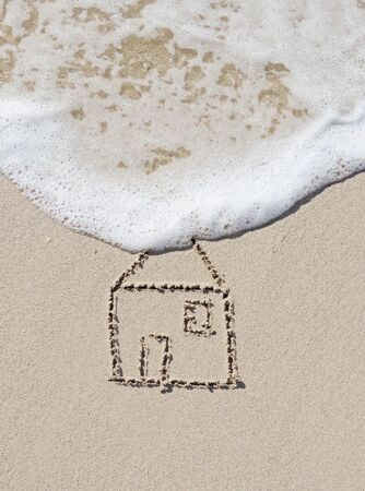 housing problems: Home, drawing on the sand Stock Photo