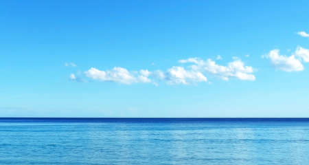 the silence of the world: Open water with copyspace. Sea scene and fluffy clouds.