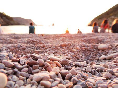 pebble beach: Pebble beach, stone beach in the sunset.