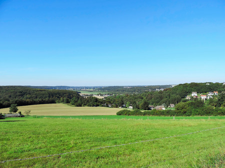 Panoramic view over fields and meadows. Idyllic landscape.