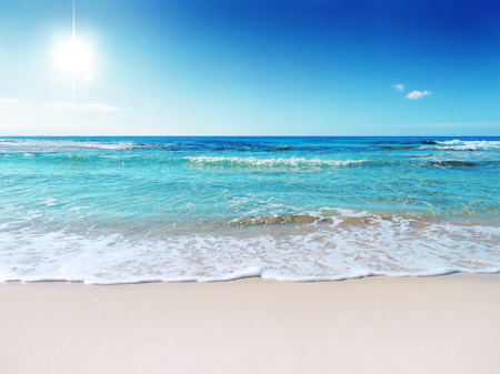 caribbean beach: Tropical beach with waves and turquoise water. Sunbeam and gently rolling waves.
