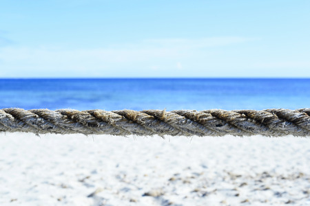 Beach barrier. Beach area, segmented with rope. Turquoise beach with blue sky and white sand in summer.