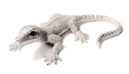 Decorative silver lizzard or gecko, isolated on white Stock Photo