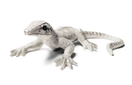 Decorative silver lizard or gecko, isolated on white