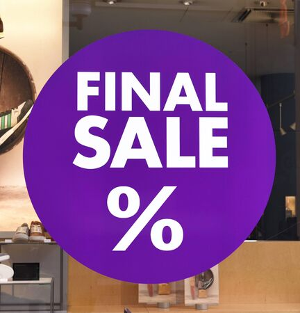 retail place: Final sale sign at a store shoes.