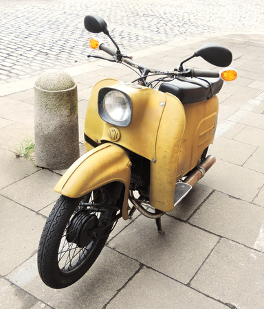 moped: Parked motorcycle, antique cheat or retro moped.