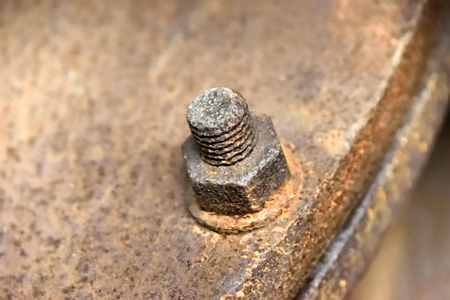 machine part: Rusty screw, machine part of an old factory
