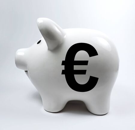 euro sign: White porcelain piggybank with euro sign