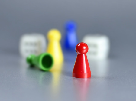 isolated on gray: Playing pieces and dice, isolated gray background