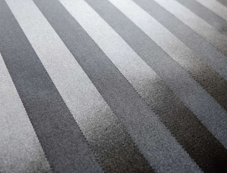 shiny black: Black satin textile with shiny stripes