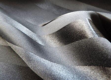 shiny suit: Black satin textile with shiny stripes