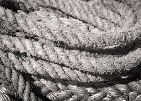 nautical   vessel: Weathered, old nautical ropes. Stack of ropes, close-up of nautical vessel. Stock Photo